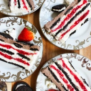 Oreo strawberry icebox cake layered with oreo cookies, strawberry filling and cream