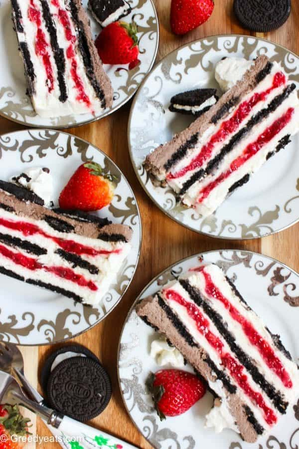 Oreo strawberry icebox cake layered with oreo cookies, strawberry filling and homemade whipped cream. This icecream cake is sure to keep you cool!