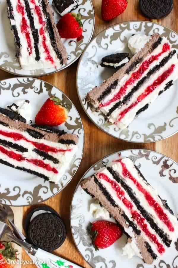 Oreo strawberry icebox cake layered with oreo cookies, strawberry filling and cream