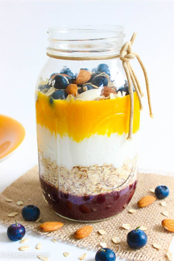Overnight oatmeal in a jar with mango and berries