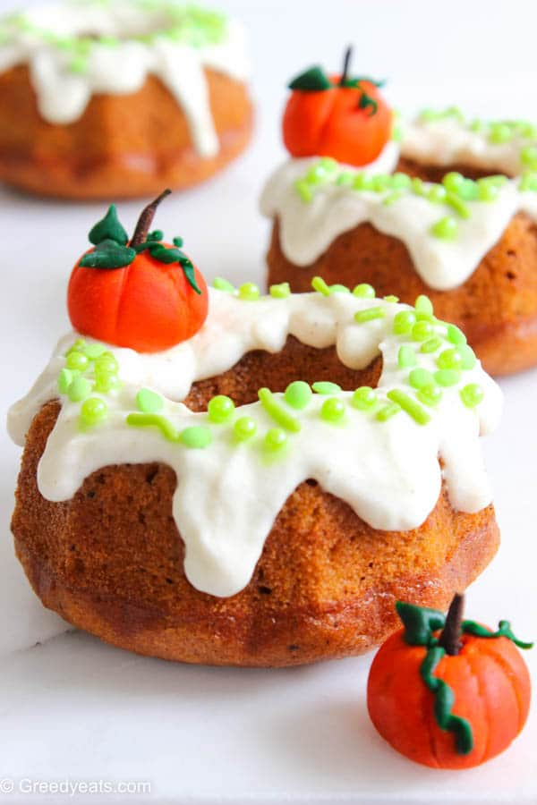 Perfectly spiced and deliciously moist mini Pumpkin Bundt Cakes topped with Cream Cheese Frosting.