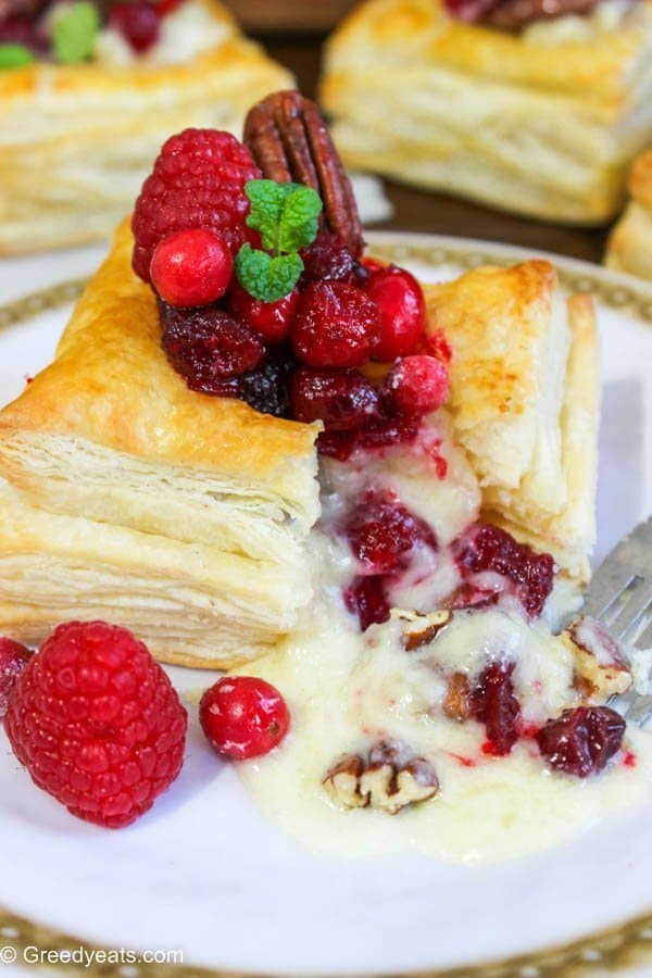 Cranberry brie puff pastry squares taste 100x better than a plain baked brie in puff pastry