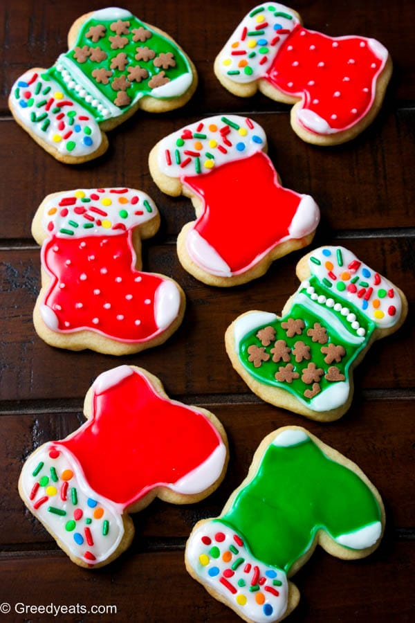 Decorated stocking cookies at greedyeats.com-cutout small batch sugar cookies recipe with easy sugar icing!