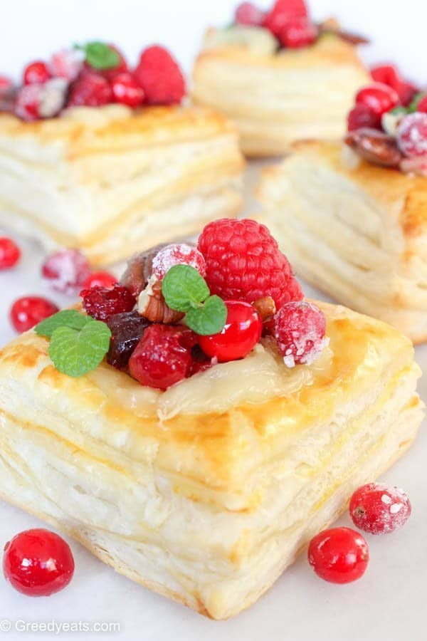 Cranberry brie pastry squares are flaky, buttery, rich and are oozing cheese all the way