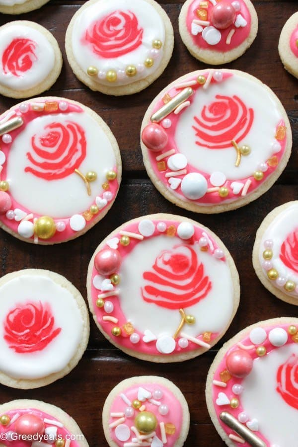 Soft and chewy cut out sugar cookies decorated as rose cookies and are topped with sprinkles. These are perfect for valentines day!