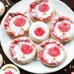 Frosted, soft, buttery and melt in your mouth sugar cookie recipe. I used royal icing to frost these as rose cookies. The most beautiful valentines cookies around!