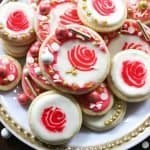 Easy cut out sugar cookie recipe decorated as rose cookies is perfect for valentines! These cookies are topped with royal icing and sprinkles.
