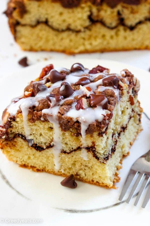Piled high with buttery cinnamon crumb, layered with chocolate and topped with vanilla glaze this coffee cake will win your heart!