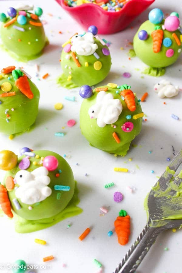 Quick, easy and fudgy chocolate easter cake pops recipe covered in candy melts and dotted with easter sprinkles