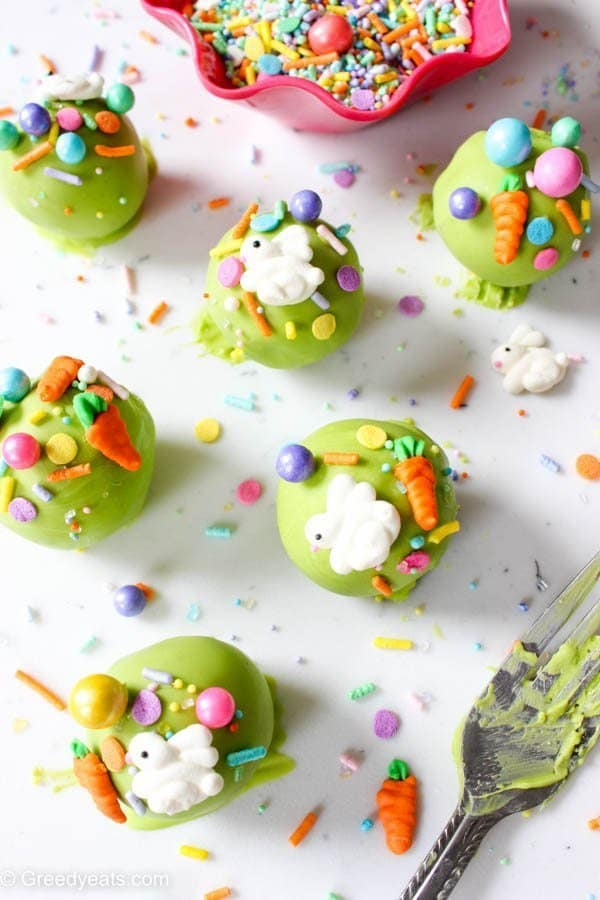 Easy and festive easter cake pops made with homemade chocolate cake, chocolate ganache frosting and easter bunny and carrot sprinkles