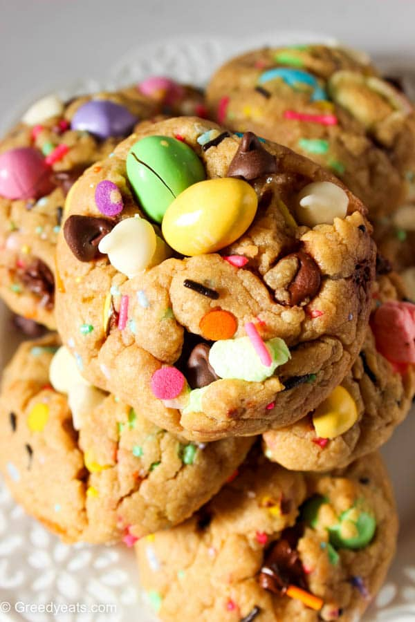 Super thick soft chewy chocolate chip cookies baked as easter cookies- with easter eggs, marshmallows, sprinkles and white chocolate chips