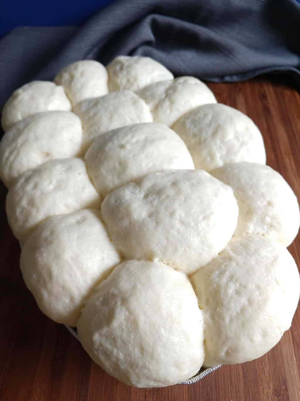 Dinner rolls proving for the second time.