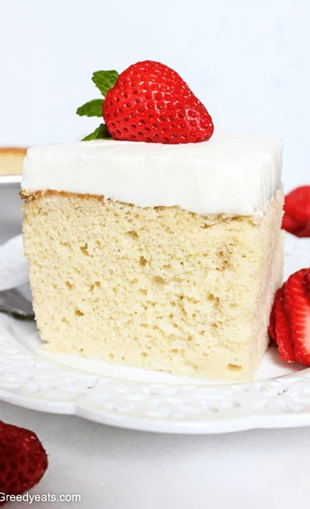 tres leches cake recipe you will love for its soft and moist sponge soaked in sweet and creamy milk.