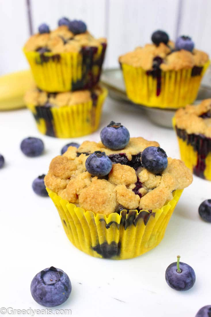 These buttery, soft and moist banana blueberry muffins are topped with thick and crunchy cinnamon streusel!