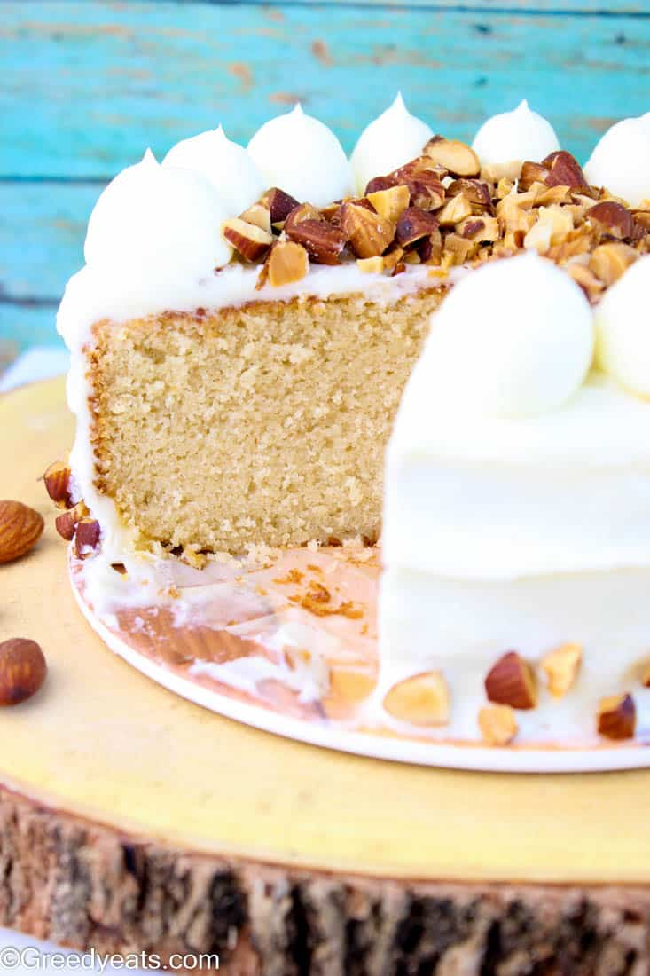 Best almond cake recipe for a soft, moist and tender cake frosted with almond cream cheese frosting!