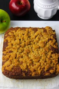 Freshly baked apple coffee cake with buttery streusel topping.