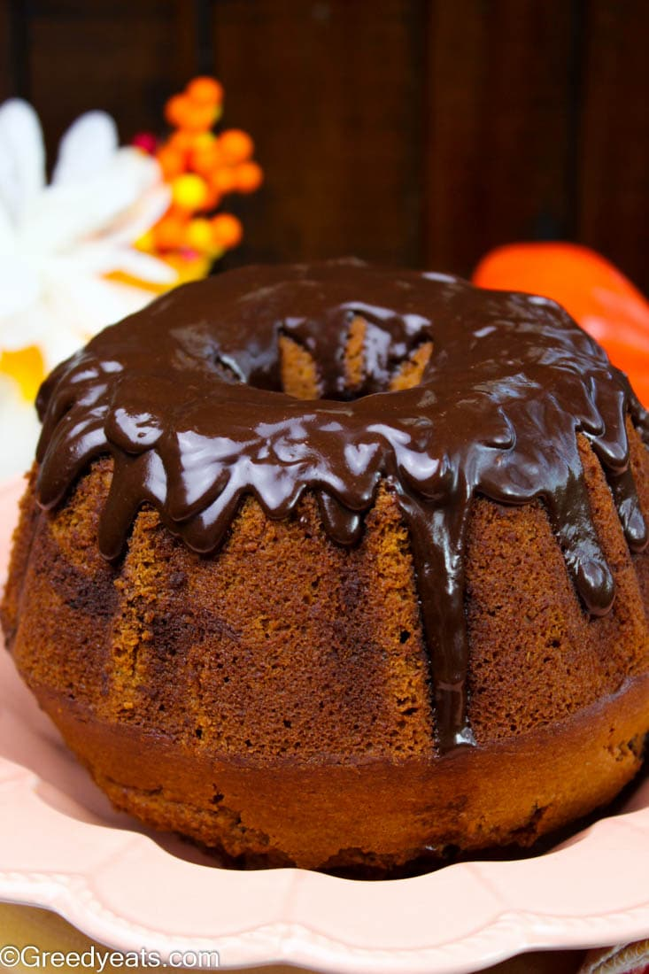 Drizzled with thick chocolate glaze recipe, this sweet potato cake rises super tall and bakes so rich and tender.