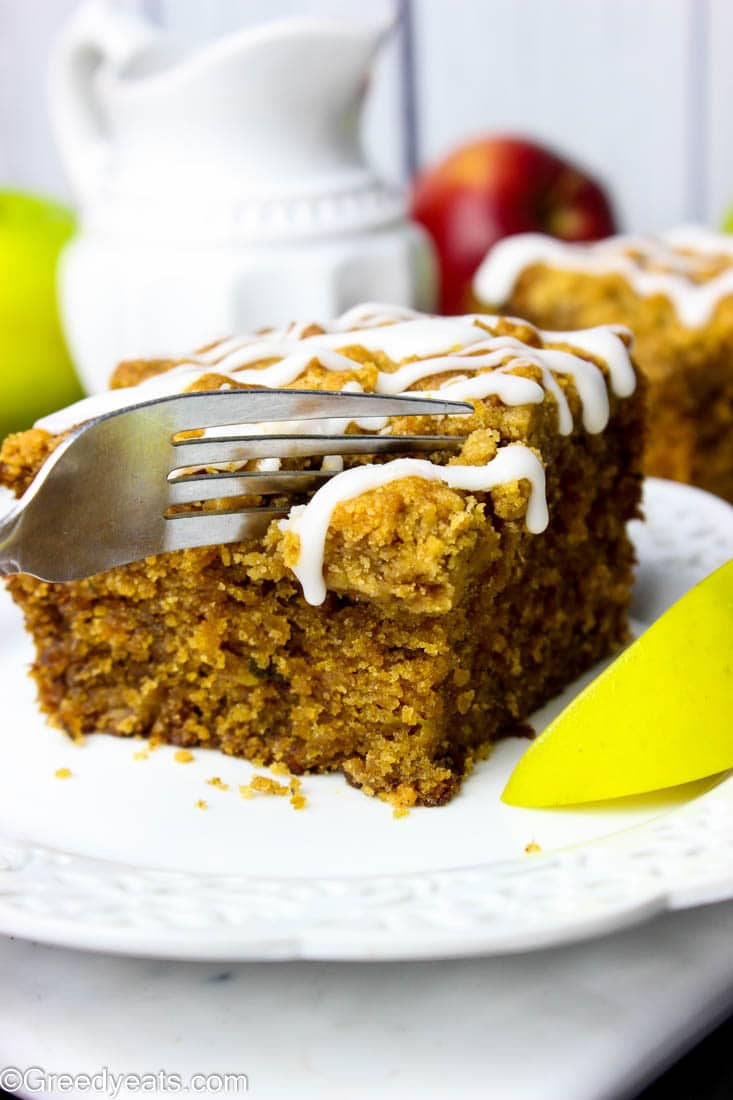 Tender, moist and easy apple coffee cake infused with fall spices and loaded with fresh apples.
