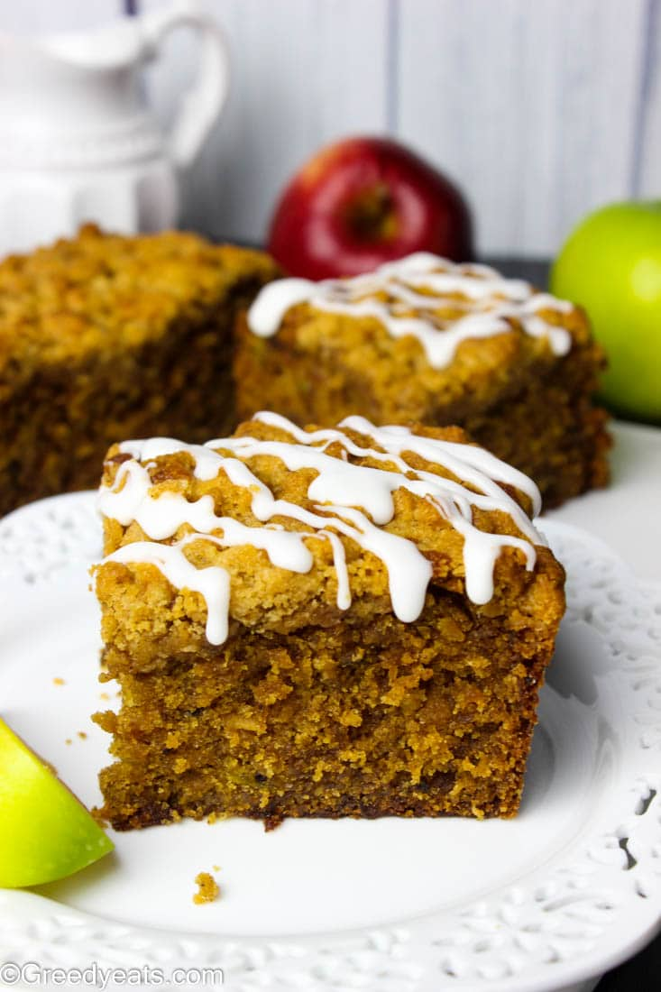 Easy apple coffee cake bursting with fall flavors and topped with buttery cinnamon streusel and vanilla glaze
