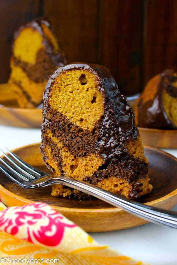 Best sweet potato pound cake recipe ever! This bundt cake is soft, tender and topped with a thick chocolate glaze.