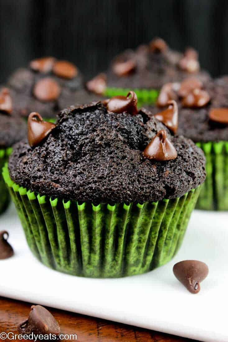 Moist, rich and decadent double chocolate zucchini muffins with pockets of melty chocolate chips.