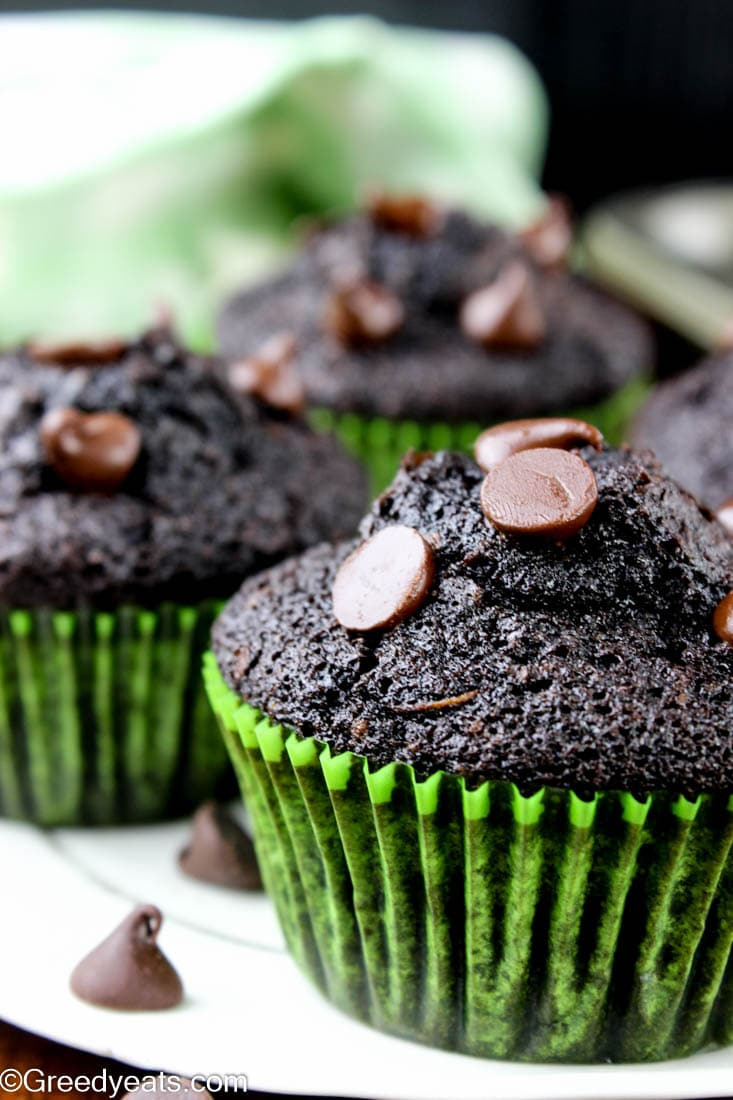 A close up click of Zucchini muffins made with chocolate of two kinds.