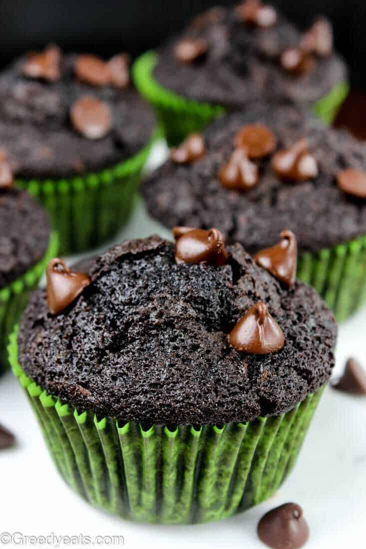 Easy, rich and fluffy chocolate flavored zucchini breakfast muffins with melty choc chips.