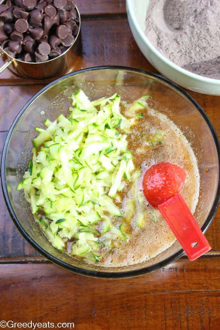 Moisture removed shredded zucchini over wet ingredients.