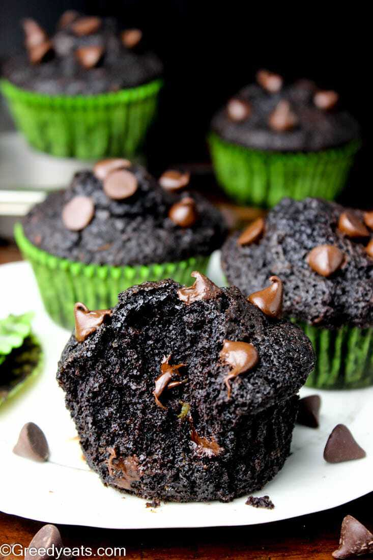 Easy Zucchini Chocolate Muffins with melty chocolate chips, taken out of liner.