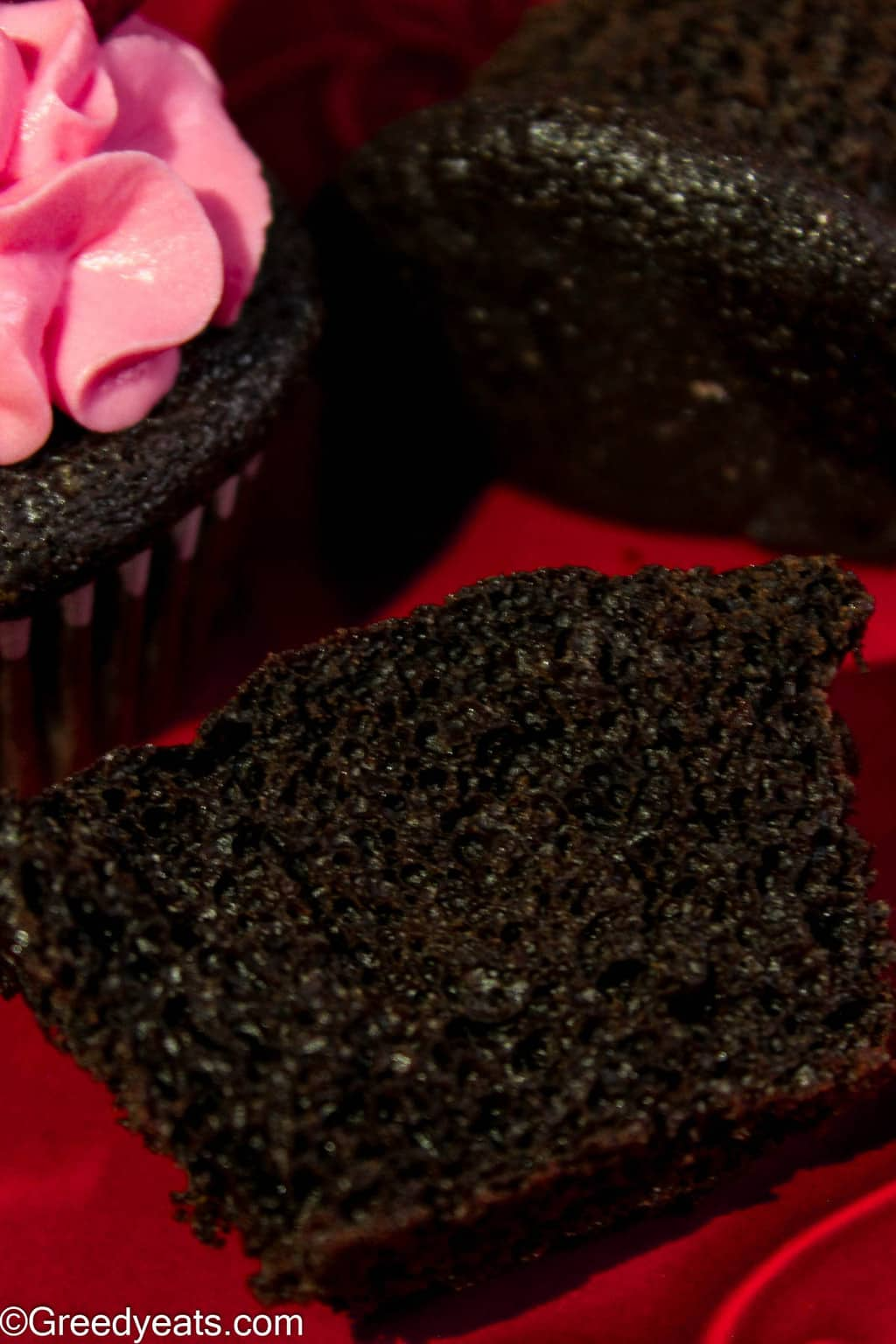 Soft, moist, decadent and easy chocolate cupcakes topped with easy strawberry frosting.