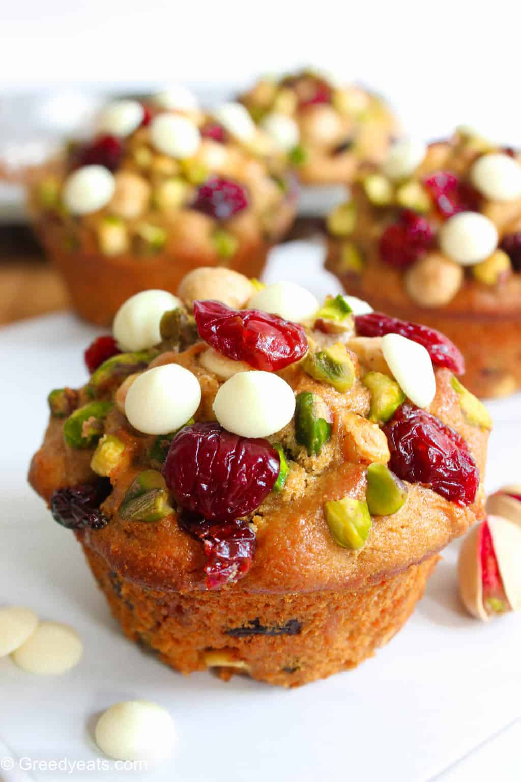 Moist, fluffy and soft Cranberry Orange Muffin recipe made with whole wheat and dotted with pistachios and white chocolate.