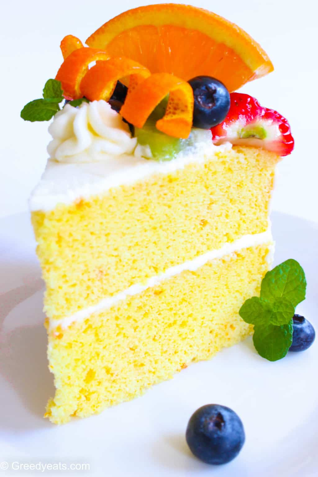 Easy orange chiffon cake recipe with fresh fruits and whipped cream!