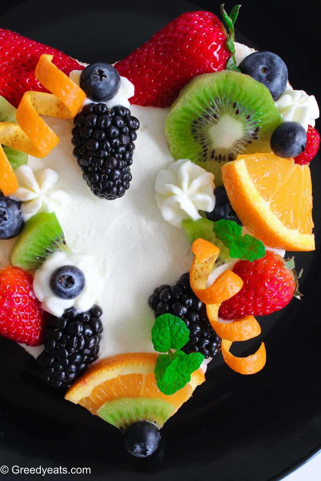 Light, fluffy and moist chiffon cake, bursting with orange flavors, served with fresh fruits.