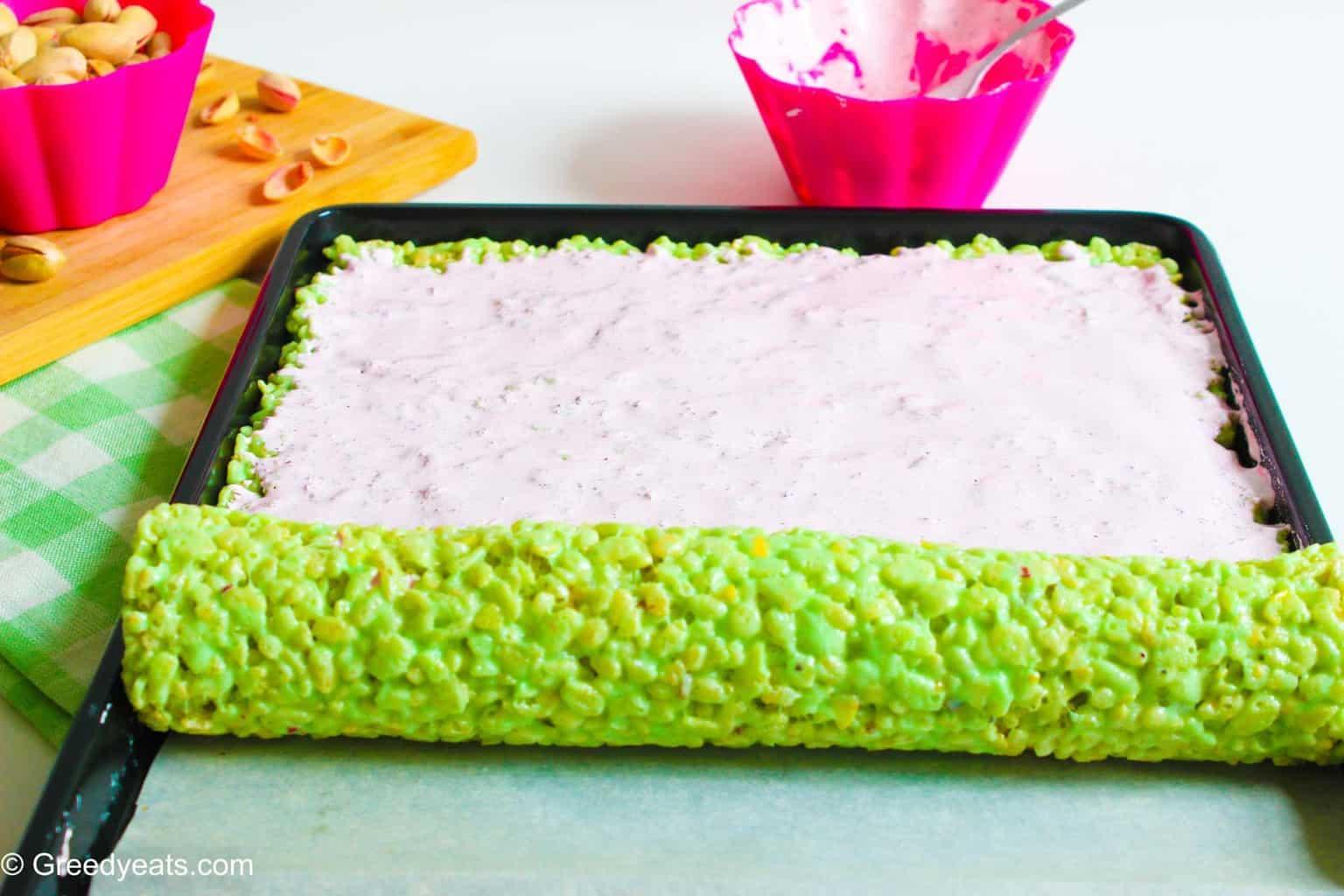 Rolling rice krispie roll up treats.
