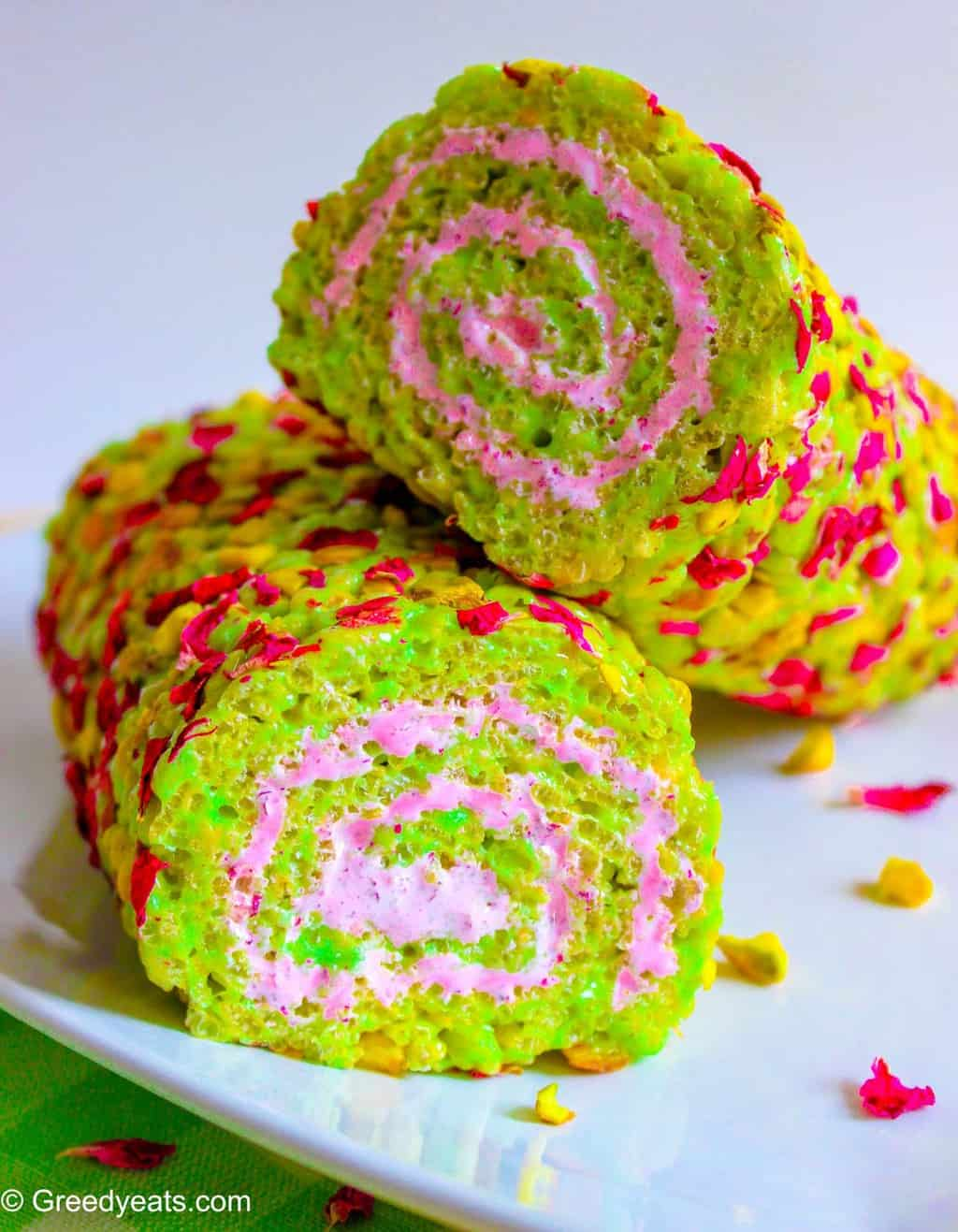 Best Rice Crispie Treats flavored with pistachios and rose, filled with pink marshmallow fluff.