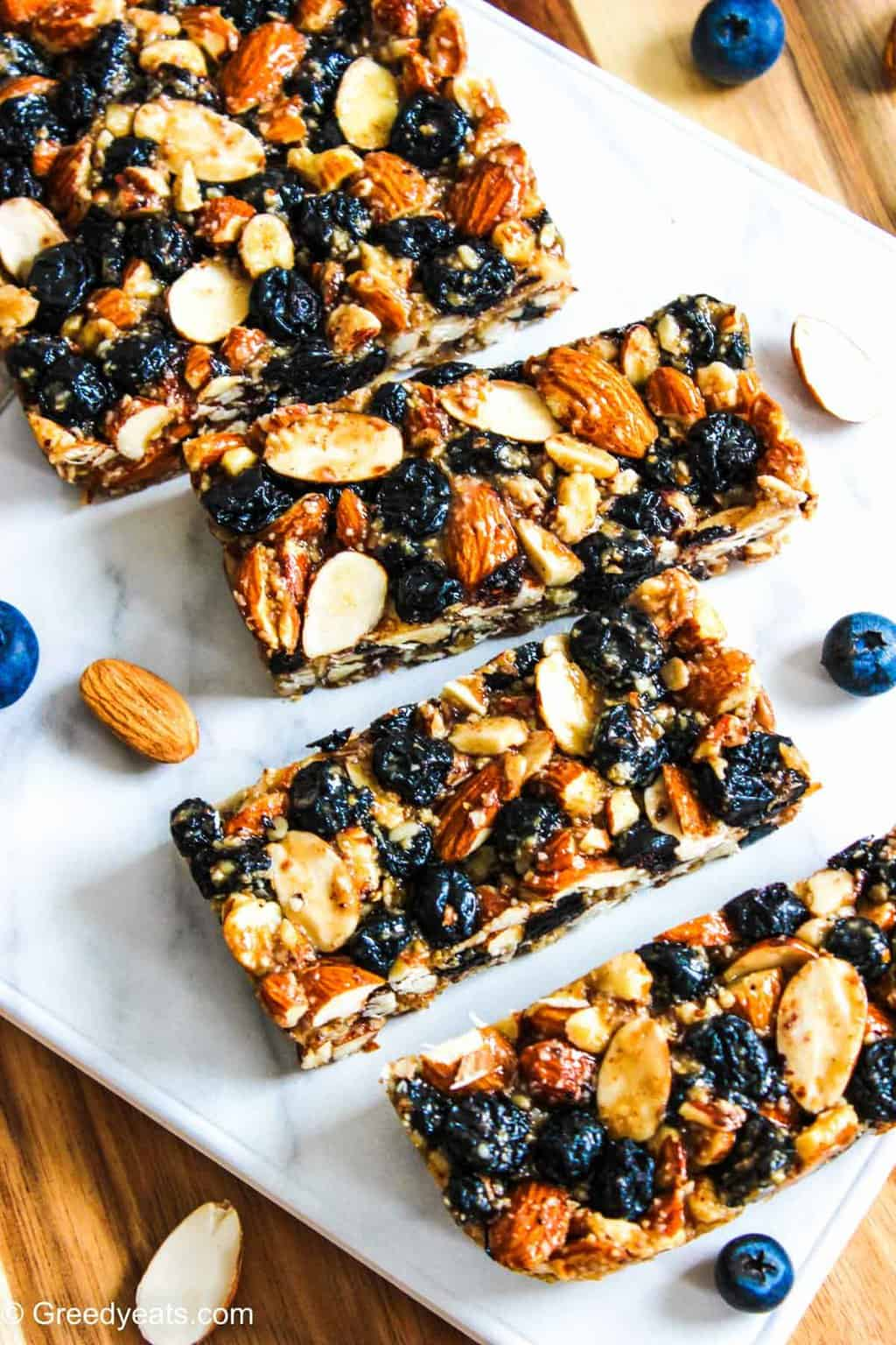 Chewy Almond Bars recipe made with all good for you ingredients. Recipe on Greedy Eats.