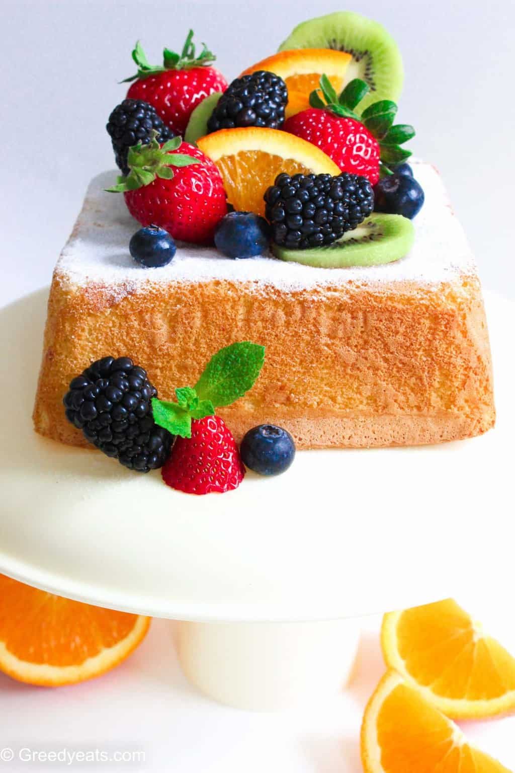 Soft, moist and fluffy Lemon Sponge Cake tipped with icing sugar and fresh fruits.