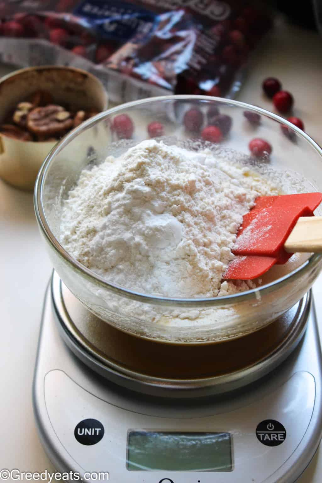 Dry ingredients like flour, leavener and salt for coffee cake in a glass bowl