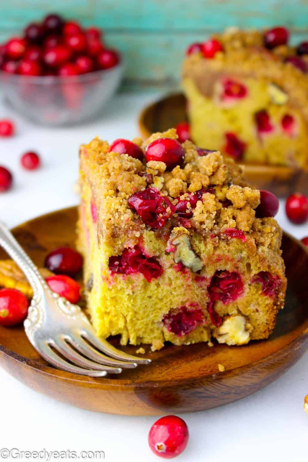 Two slices of Easy Buttermilk Coffee Cake with cranberries and toasty pecans.