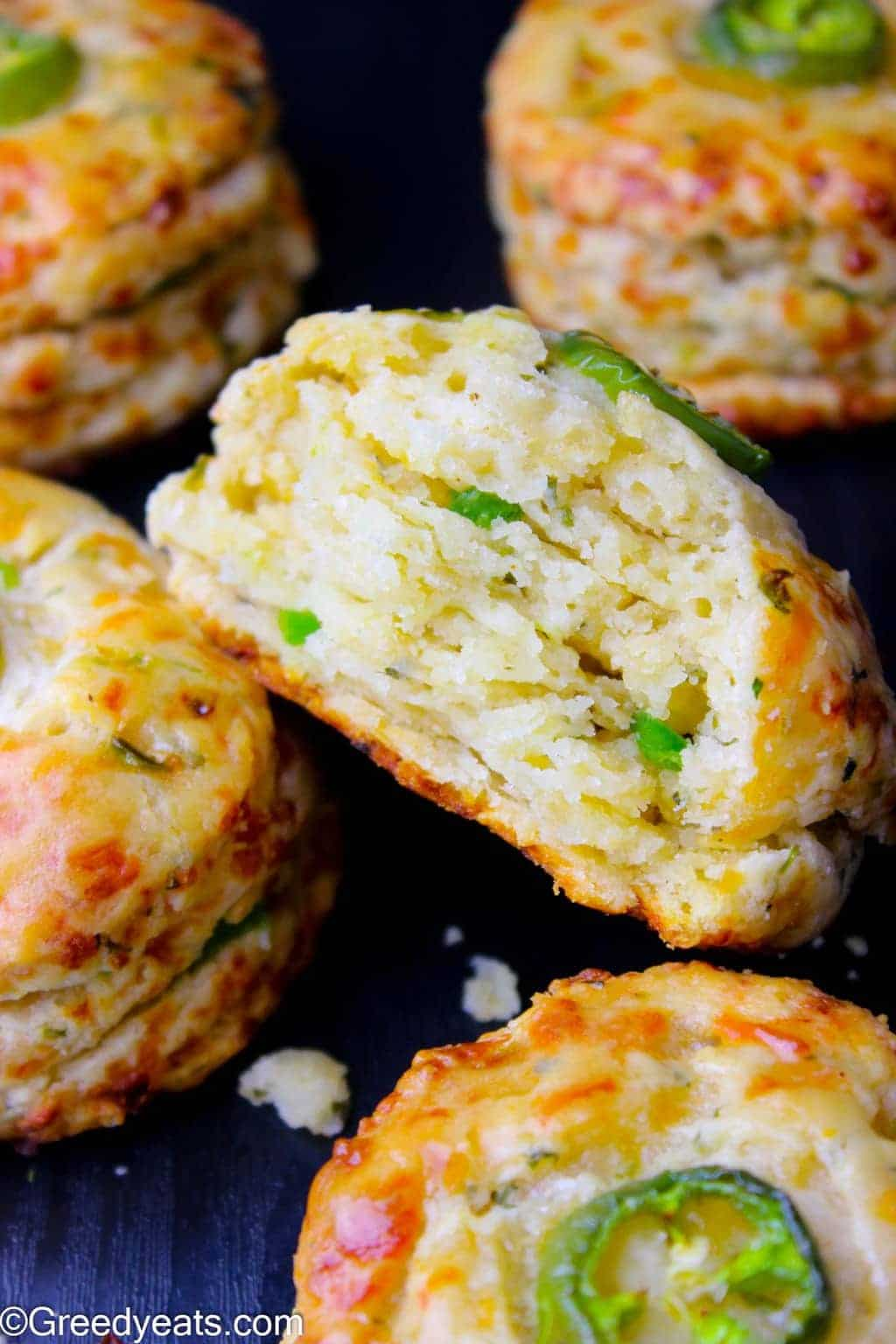 Tall and flaky Jalapeno Cheddar Biscuits recipe made with buttermilk, some garlic powder, fresh jalapeno peppers and cheddar cheese.