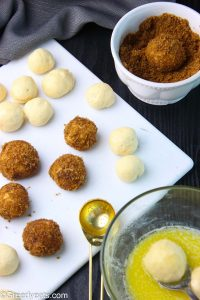 Melted butter and Cinnamon sugar coated bread dough balls