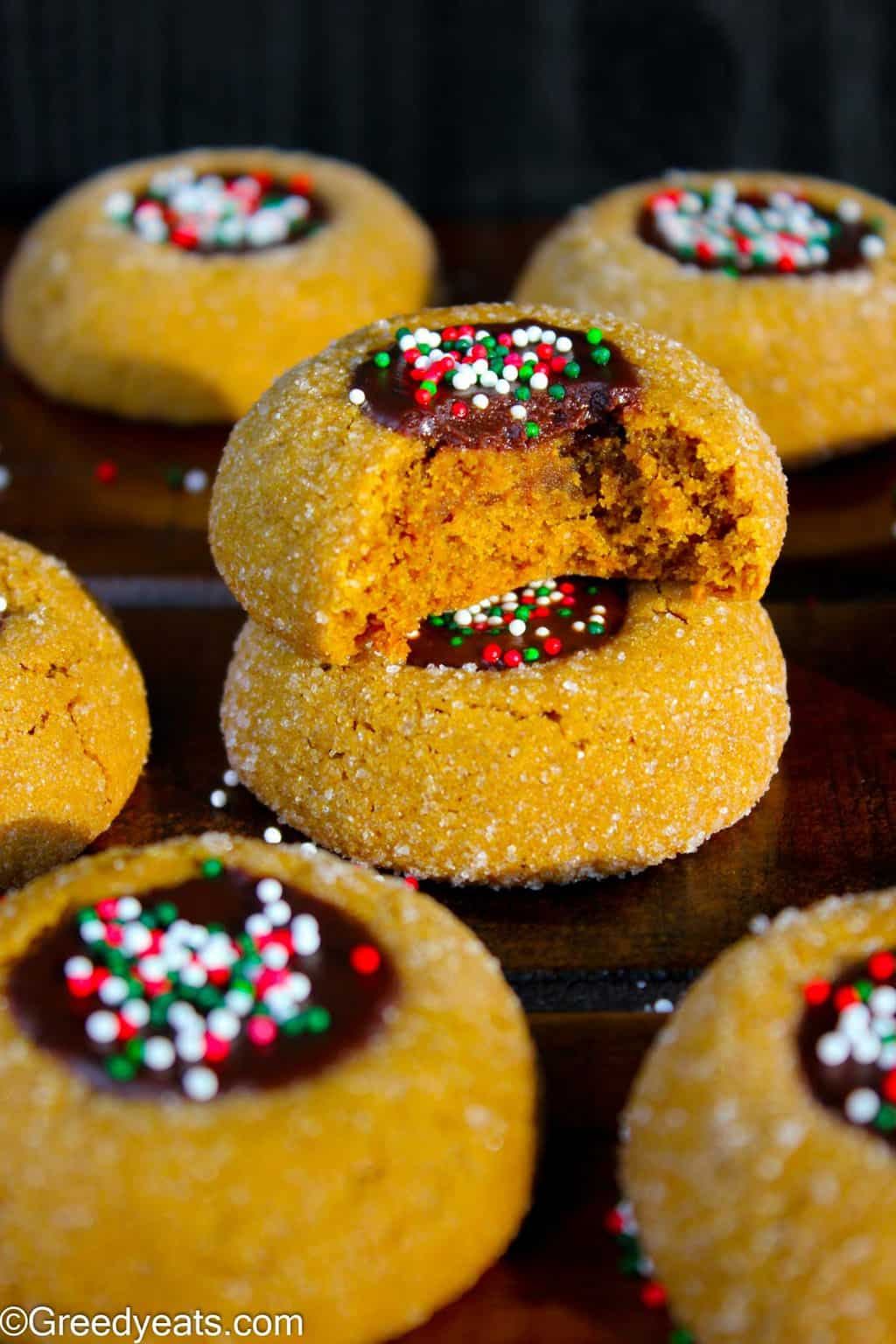 Soft, thick and chewy Molasses cookie recipe with chocolate filling and Christmas sprinkles.