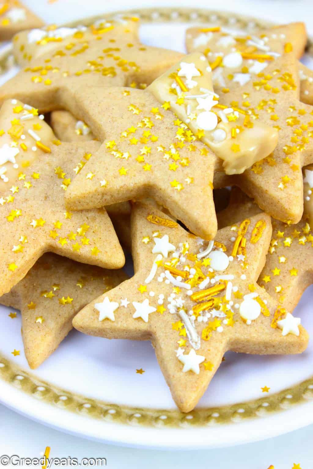 Soft, chewy and thick star sugar cookies flavored with cinnamon and maple icing.