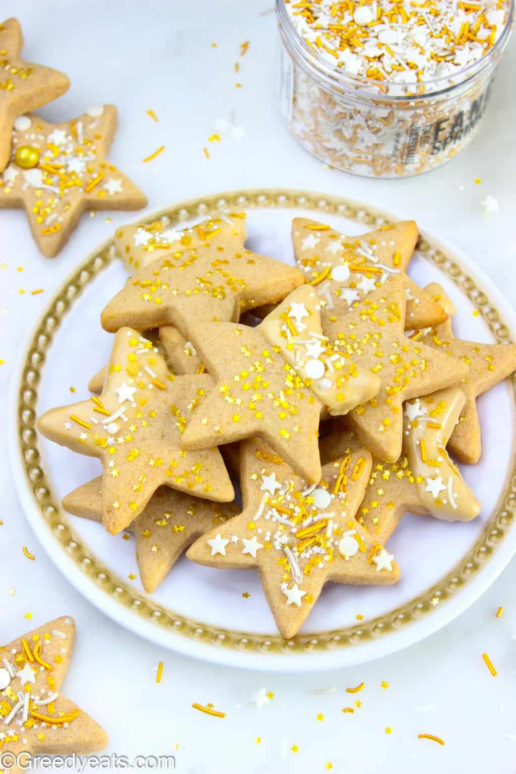 Easy sugar cookies recipe cut with star cookie cutter and flavored as Maple Cinnamon Cookies!