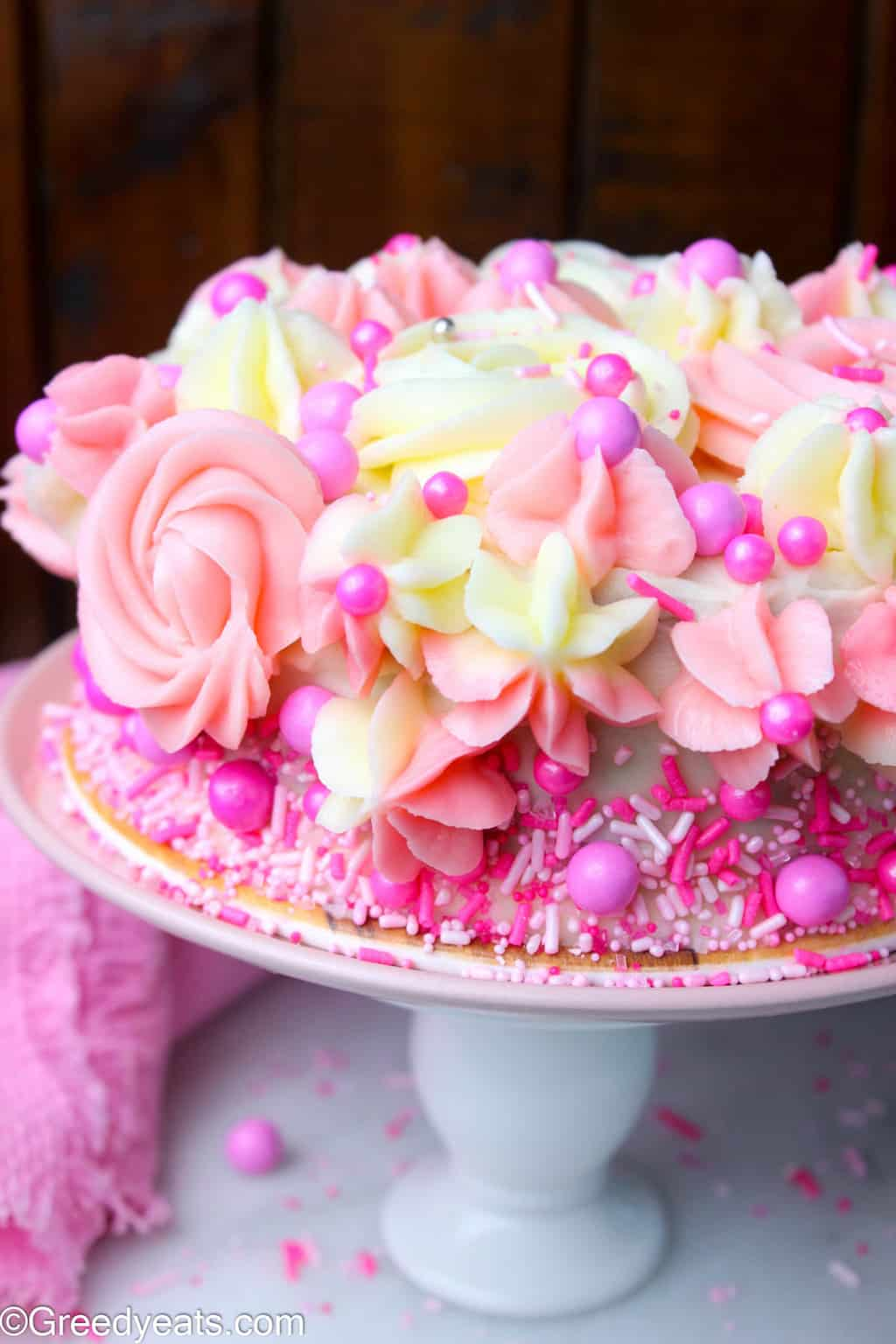 Single layer vanilla cake with pink vanilla frosting. Perfect as Valentines Cake recipe.