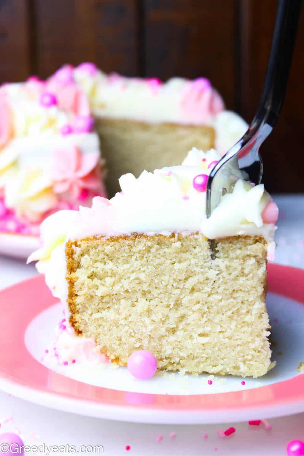Small Vanilla Cake recipe with super soft crumb and creamy vanilla buttercream frosting.