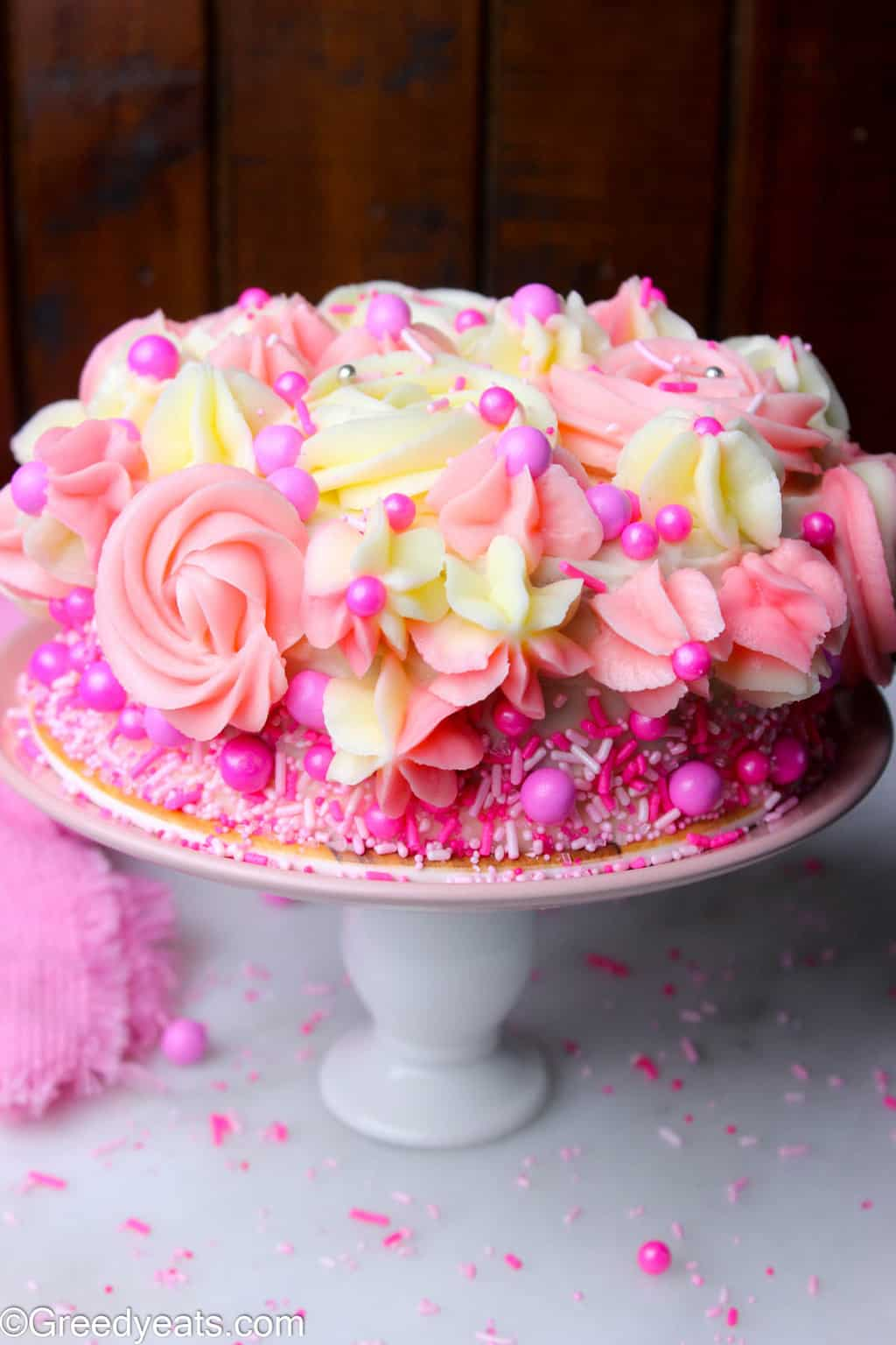 Single layer 6 inch vanilla cake recipe with easy vanilla buttercream frosting.