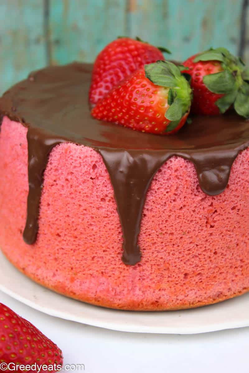 Fresh strawberry Cake topped with easy Chocolate Ganache and 3 fresh berries.