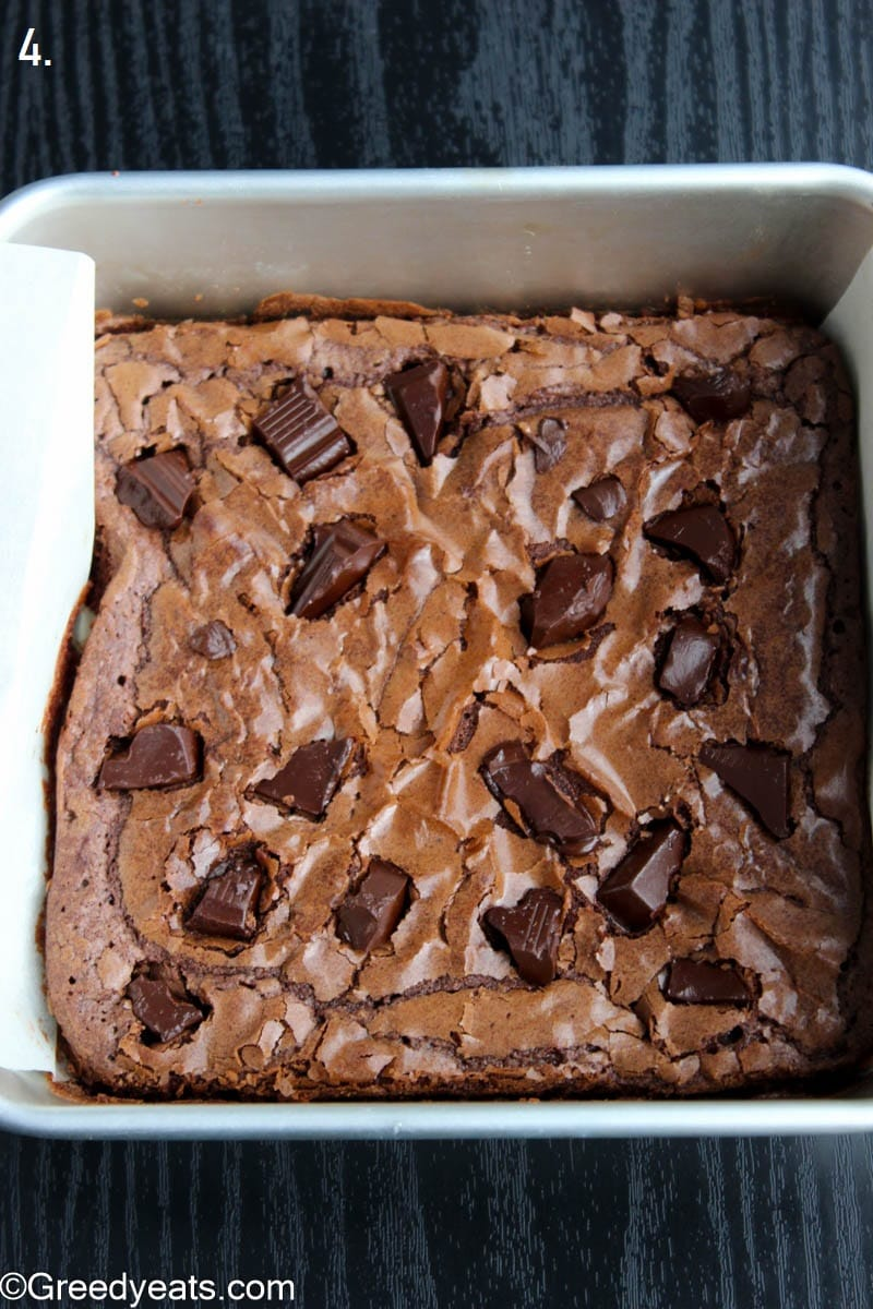 Baked brownies with crinkly and shiny tops in a square pan.