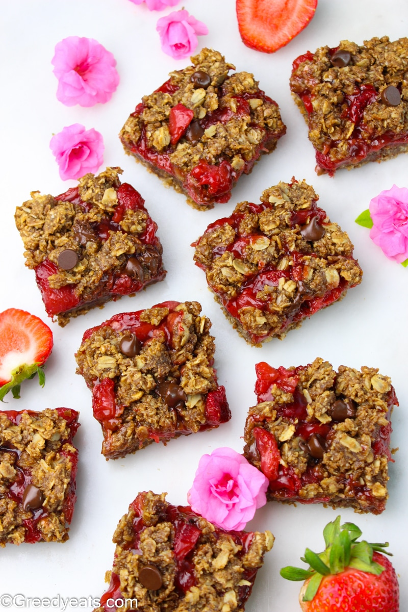 Freshly baked oats squares oozing with juicy strawberry filling.